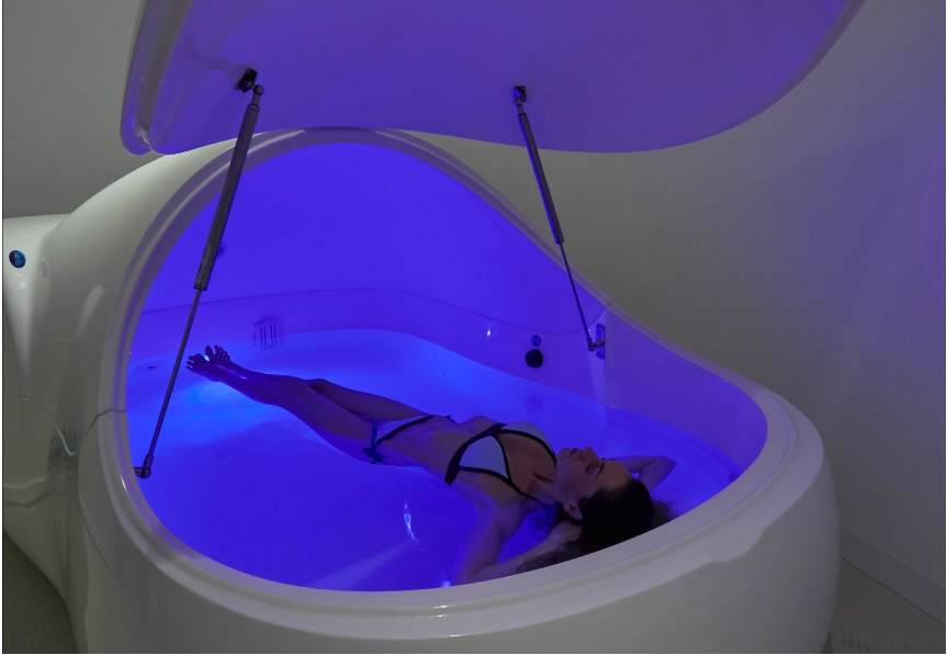 woman floating in float pod at Beyond Rest, Australia