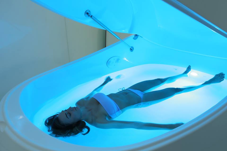 woman floating in float pod at Float Harder in Portland Maine