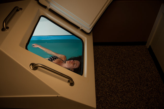 Woman in float tank at Healing Waters