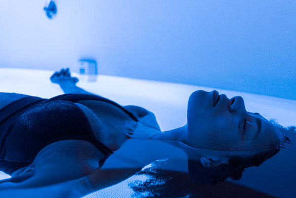 woman floating in sensory deprivation tank