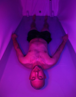 Awaken for Wellness client and personal trainer Max Sagert floats in an epsom-salt-saturated tank to relieve stress and muscle tension
